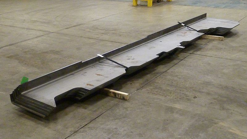 2 thick formed steel parts shows off the amazing length we can handle in bending thereby avoiding welding 2 shorter 10 foot pieces together.