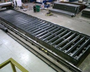 Downdraft table system 16 feet wide by 66 feet long for a laser cutting machine installation in Minnesota.