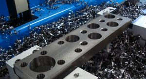 Drilling of large and multiple sized holes in parts in one setup shows capacity for large diameter drilling in very heavy plate.