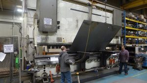 Large panel being formed on 20 foot long brake press shows we have the capacity to crane heavy and large parts for bending.