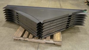 Large panels that were laser cut and formed and welded at VeriForm to be installed in overhead structures.