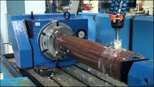 Really productive and time-saving chuck head showing CNC drilling of round pipe and structurals all in one setup.