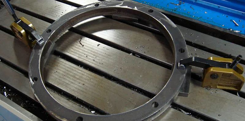 Rings can be placed on our CNC machining center and drilled without needing a chuck which means fast setup and turnaround time for you.