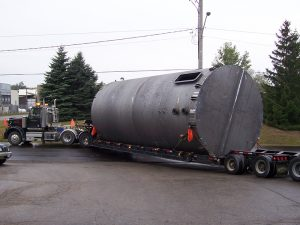 Thirteen foot diameter tank shipping out of VeriForm to customer ready for use.