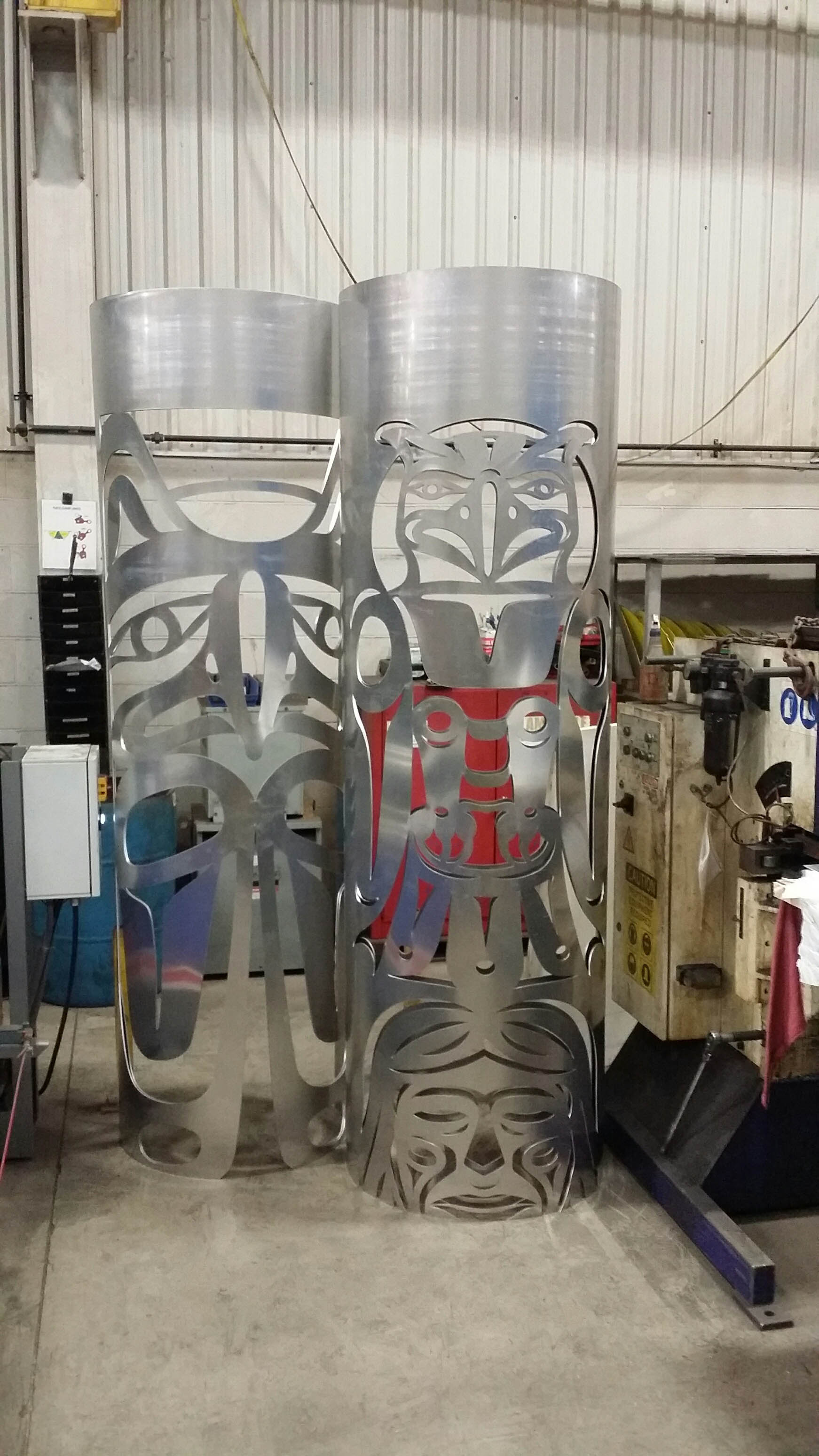 Totem poles laser cut from aluminum and rolled for an award show in western North America.