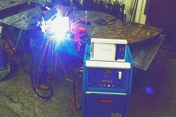 Welding large assemblies while using a special machine to stress relieve the welding DURING welding eliminates post weld stress relieving by up to 95 percent.