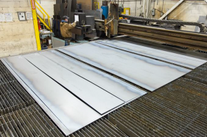 Multiple sheets of steel can be cut on our large 18 foot by 28 foot high definition plasma cutting table built by VeriCUT Inc., our sister division.