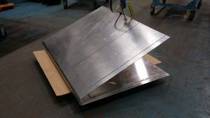Following is a 1/8 inch thick aluminium corner sign section rolled with an acute 2 inch radius nearly 180 degrees.