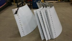 Following are 3/16 inch thick aluminium light shades rolled for an American casino where the sections are in quarters and bolted together for an aesthetic effect.