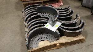 These are gear shrouds and guards rolled from 1/8 inch thick steel and welded for installation on a mining truck.