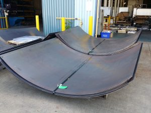 The following photo is showing large 0.25 inch thick steel panels rolled with windows for access holes.