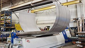 This photo shows a large 220 inch long sheet being rolled using a 2 hook lifting system to roll a half circle with a diameter of 172 inches.